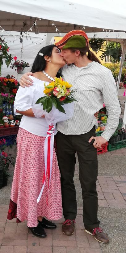 Naila and Elliott kiss in the Plaza Central of La Calera